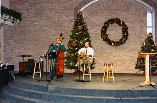 Cellist and Guitar Player Perform During Christmastime