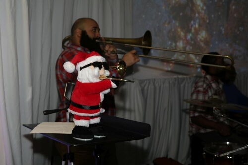 Toy Santa Joins Trombone Player