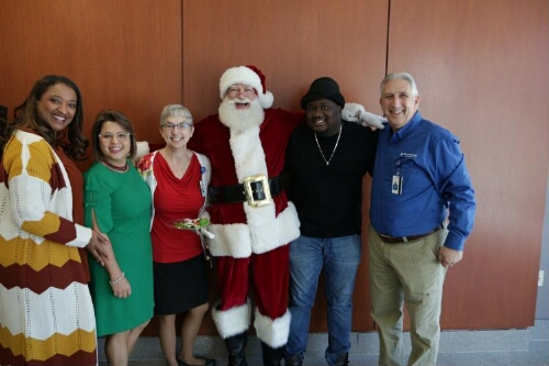 Santa Poses with Dr. Stephen Roche, Ndala Booker, and Others
