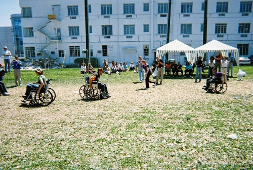 Green, Orange, and Purple Teams Race in Wheelchairs