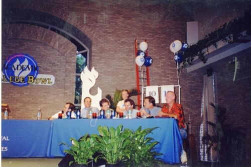 Men Sit Together on Stage at the Celebrity Academic College Bowl