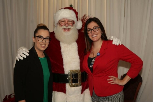 Santa Smiles and Poses with Two Women  Close-up